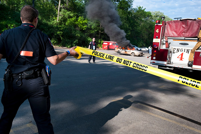Members of the University Police Department work with the Madison Fire department and other emergency personnel to respond to a mock car explosion and fire during a training drill.