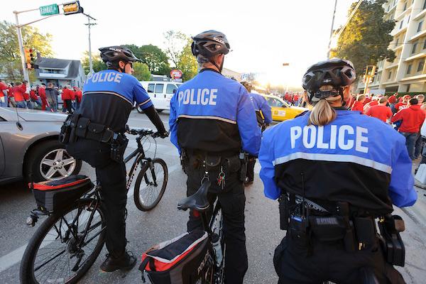 Police on bikes patrol during the Nebraska football game at UW.