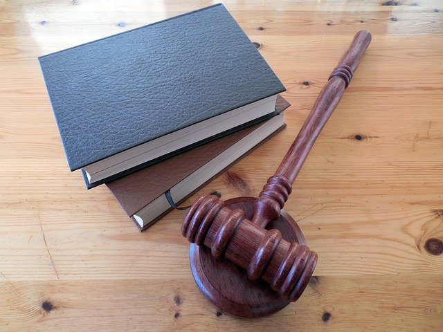 Photo of a gavel next to law books.