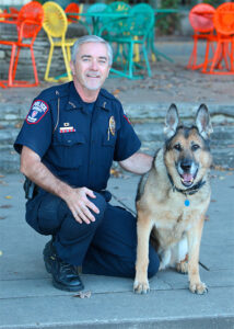 Detective Shane Driscoll with K9 Rex.