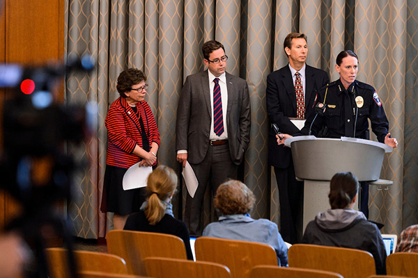 As part of a campus emergency-response exercise, UW Police Department Chief Kristen Roman speaks during a mock press conference, accompanied by Chancellor Rebecca Blank, Laurent Heller and Charles Hoslet.