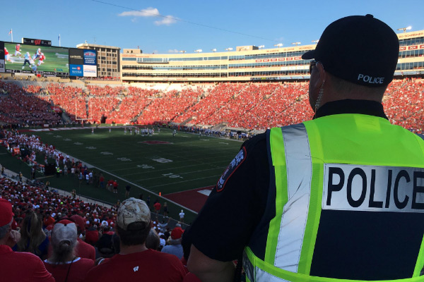 A police officer working at a Badger Football game.