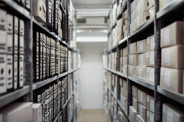 A view of shelves stacked with numerous boxes of records.