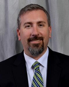 Headshot of Jason Whitney