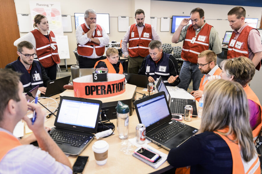 Members of the operations team meet as university leaders, staff and emergency management personnel reported to an Emergency Operation Center (EOC).